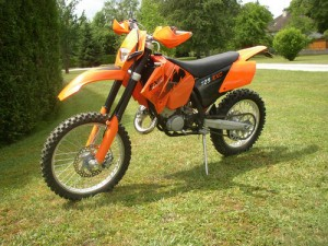 photo de KTM EXC 125 occasion de couleur orange en vente à Paris 05 n°1