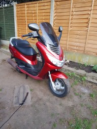 photo de PEUGEOT ELYSTAR 125 occasion de couleur rouge en vente �  Yvoire